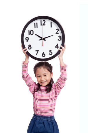 Asian little girl smile and hold a clock over her head photo