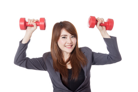 Asian office girl holding 2 dumbbells and smile