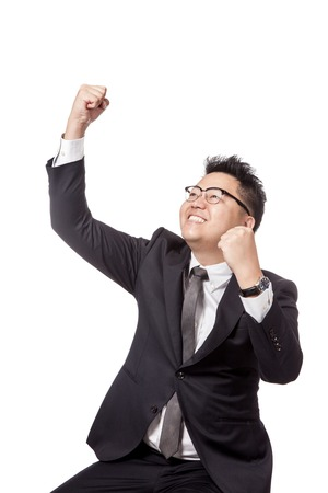fist pump: Asian businessman do fist pump for success isolated on white background