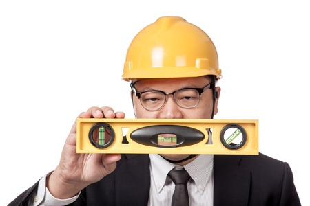 Asian businessman look at a spirit level isolated on white background photo