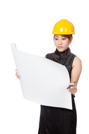 asian architect: Asian architect girl read a blueprint seriously isolated on white background