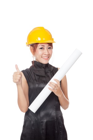 Happy Asian architect girl wear hardhat and show a plan and thumb up isolated on white background photo