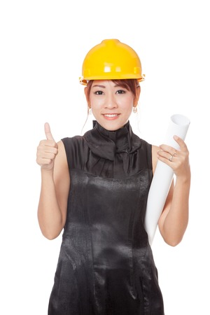 Asian architect girl wear hardhat and hold plan in her hand show thumb up isolated on white background photo