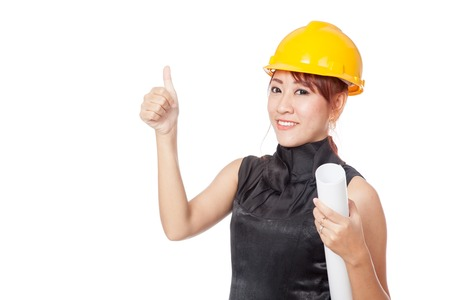 asian architect: Asian architect girl wear hardhat and hold plan in her hand show thumbs up isolated on white background Stock Photo