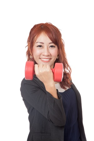 Happy Asian office girl lift a red dumbbell and smile  isolated on white background photo