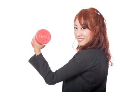 Asian office girl lift a red dumbbell and smile isolated on white background photo