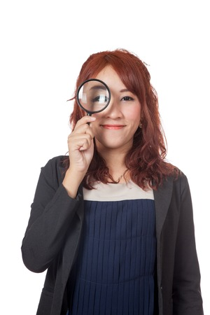 Asian office girl look through magnifying glass and smile isolated on white  Stock Photo - 28012335