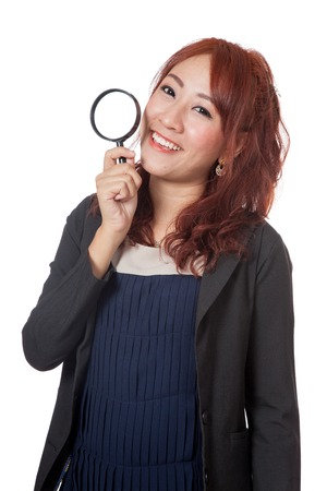 Asian office girl hold magnifying glass and smile isolated on white Stock Photo - 28012361
