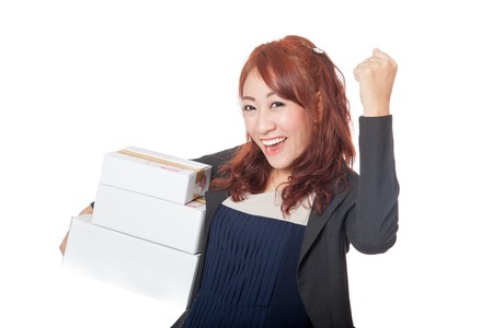 fist pump: Asian office girl very happy with 3 boxes and fist pump isolated on white background