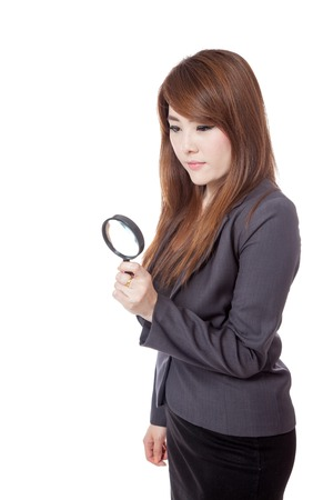 Asian businesswoman use magnifying glass looking down isloated on white background Stock Photo - 28012384
