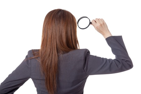 Back view of Asian businesswoman use magnifying glass isolated on white background Stock Photo - 28012382