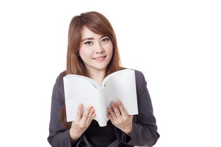 Asian businesswoman is reading  a book and smile isolated on white background photo