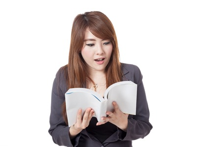 knowlage: Asian businesswoman is excited  reading  a book isolated on white background