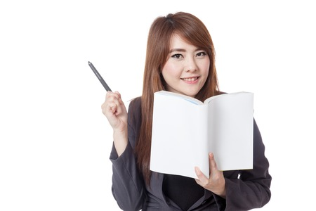knowlage: Asian businesswoman smile  read a book and point a pen to her right isolated on white background