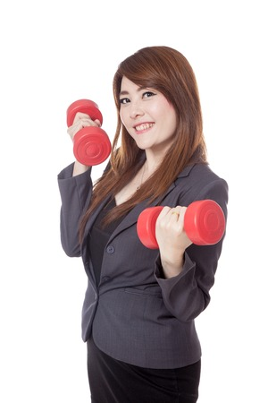 Asian businesswoman lift dumbbells and smile isolated on white  photo