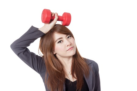 Asian businesswoman hold a dumbbell over her head isolated on white  photo