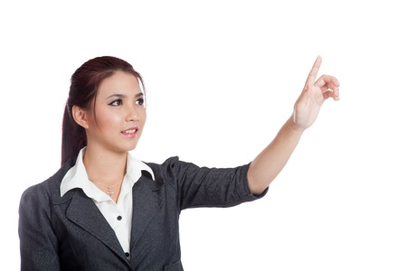Asian business woman touching the screen with her finger photo