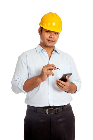 Asian engineer man hold a cellphone and a pen isolated  photo