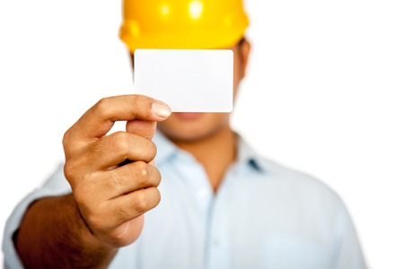 name card: Asian engineer man show a blank card close his face focus on the card isolated
