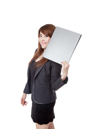 Asian Businesswoman show a folder next to her face isolated on white background photo