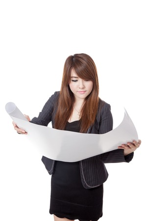 asian architect: Asian architect girl reading a plan  isolated on white background