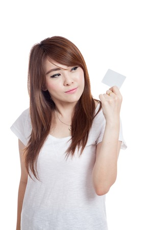 white card: Asian girl look at a white card and smile isolated on white background Stock Photo