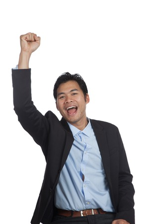 fist pump: Asian businessman happy do fist pump isolated on white background