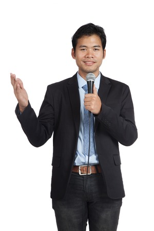 Asian businessman speaking with microphone isolated on white background