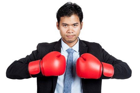 Asian businessman with red  boxing glove isolated on white background photo