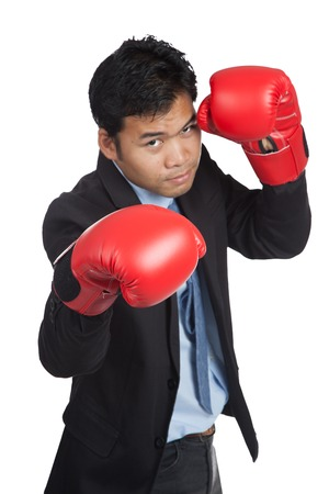 Asian businessman ready to fight  with red  boxing glove  isolated on white background photo