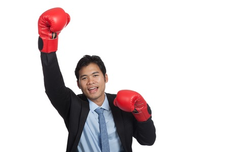 Asian businessman win fight fist pump for success isolated on white background photo