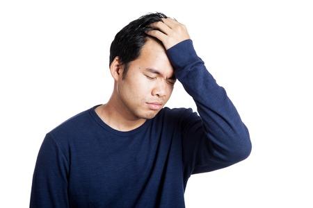 Portrait of headache Asian man isolated on white background Foto de archivo