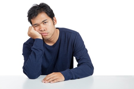 Asian man bored  isolated on white background 스톡 콘텐츠
