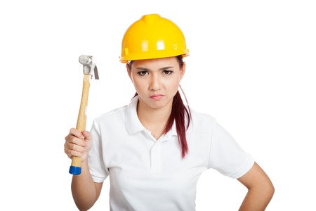 Angry Asian engineer girl hold a hammer isolated on white background