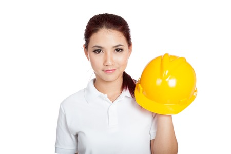 informal clothing: Asian engineer girl hold a hardhat and smile isolated on white background