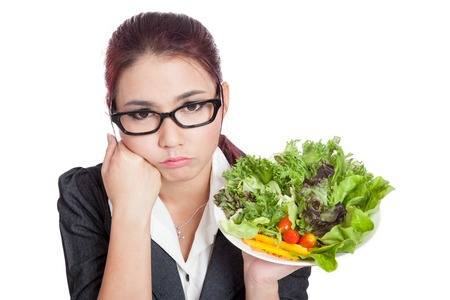Asian business woman bored with salad bowl  isolated on white background 스톡 콘텐츠