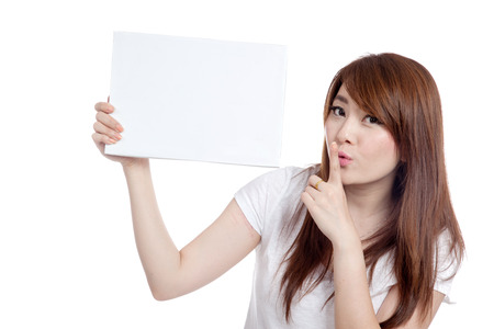 Asian girl hold blank sign and do quite sign  isolated on white background