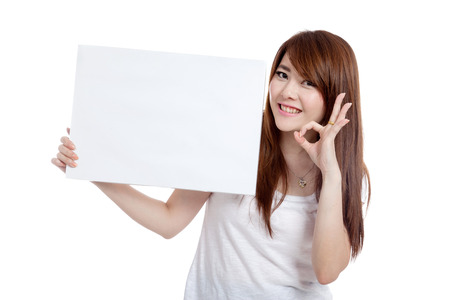 Asian girl hold blank sign show OK sign  isolated on white background