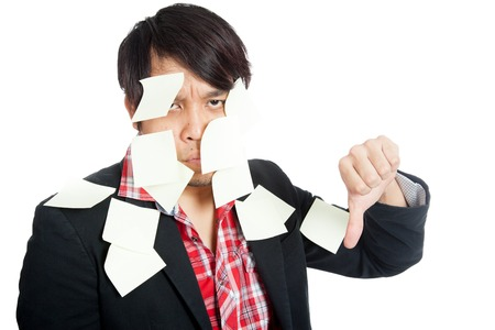 Asian office man covered in blank notes with his thumbs down  isolated on white background photo