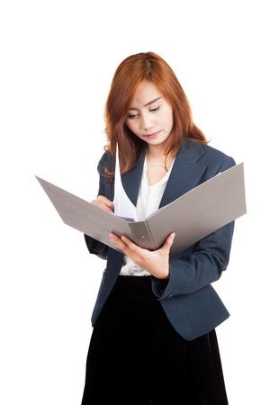 Asian office girl reading data in folder  isolated on white background photo