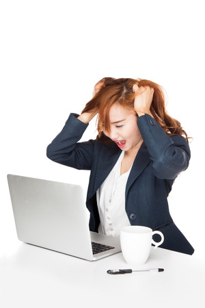 Frustration Asian office girl look at PC  isolated on white background Banco de Imagens