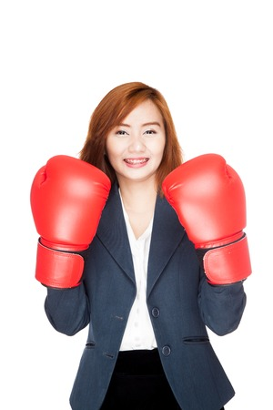 Asian businesswoman with boxing glove  isolated on white background photo