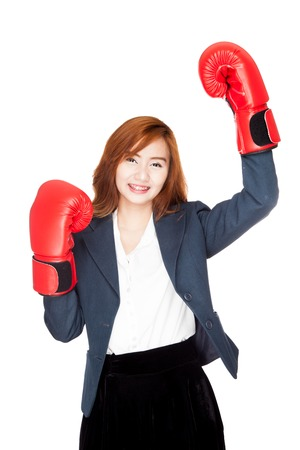 fist pump: Success Asian businesswoman with boxing glove fist pump  isolated on white background Stock Photo