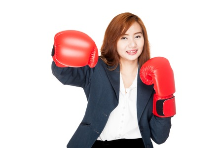 Happy Asian businesswoman punch with boxing glove  isolated on white background photo