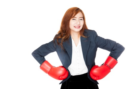 Asian businesswomanarms akimbo  with boxing glove  isolated on white background photo