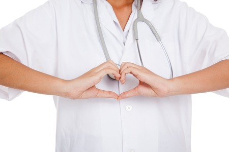 asian nurse: Doctor show heart hand sign  isolated on white background Stock Photo