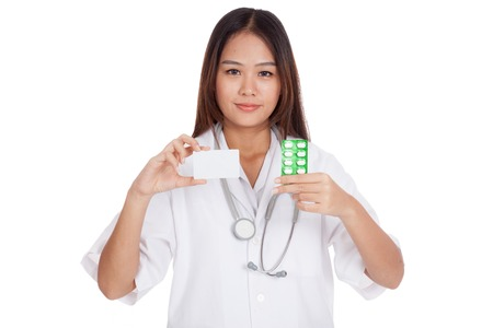 Asian young female doctor show a blank card with medicine  isolated on white background photo