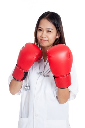 Young Asian female doctor guard with boxing glove   isolated on white background Stock Photo