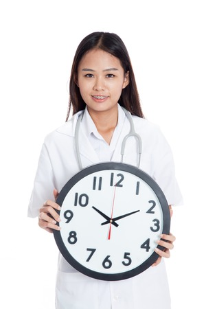 Young Asian female doctor hold a clock  isolated on white background photo