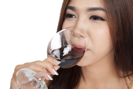 Close up of Beautiful Asian woman drink red wine  isolated on white  photo